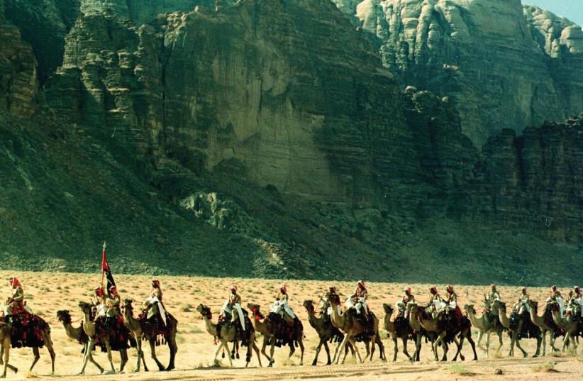 Men on camels near Wadi Rum (photo credit: REUTERS)