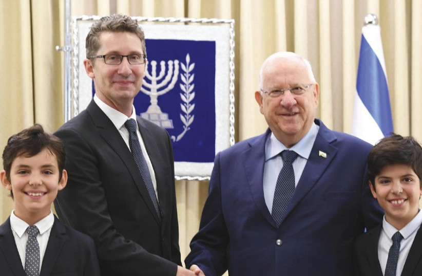 Israeli President Reuven Rivlin with Australian Ambassador Chris Cannan and his sons  (photo credit: MARK NEYMAN / GPO)