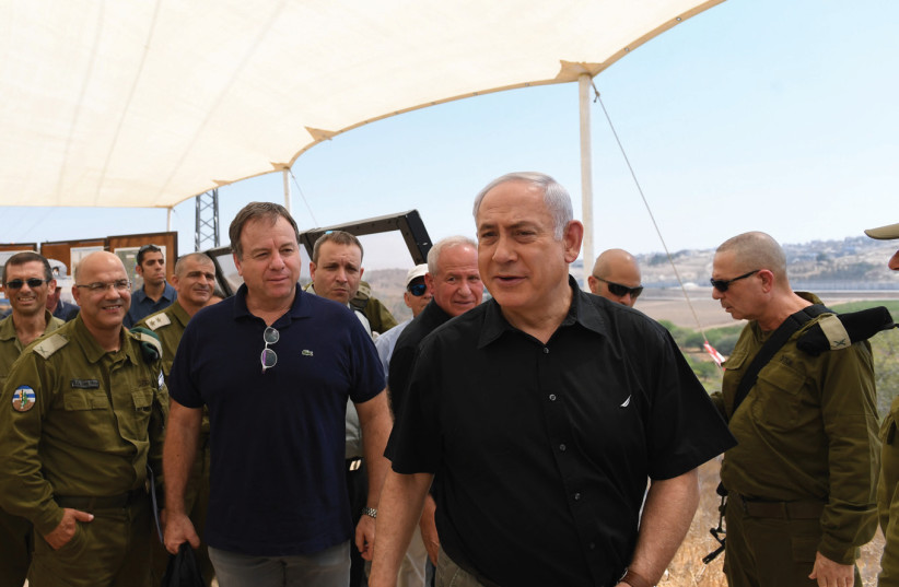 Prime minister Benjamin Netanyahu tours sections of the West Bank security barrier's southern loop yesterday with members of the security cabinet and others.  (photo credit: GPO)