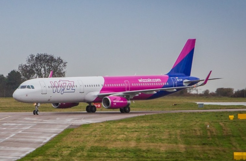 Wizz Air plane seen on the runway (photo credit: COURTESY OF WIZZ AIR)