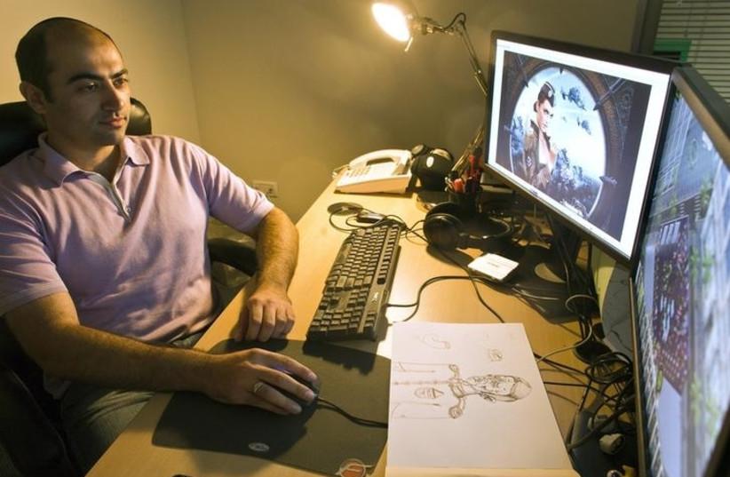 Plarium CEO Avi Shalel sits in his office in Herzliya near Tel Aviv July 10, 2012. (photo credit: REUTERS)
