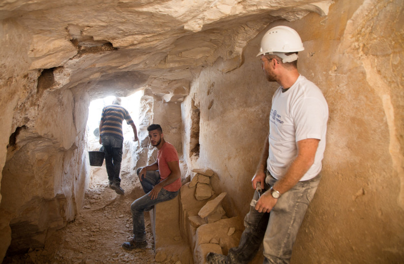 Archaeological excavations inside the ancient workshop. (photo credit: Israel Antiquities Authority)