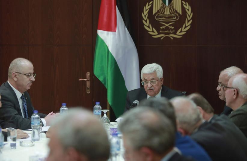 Palestinian president Mahmoud Abbas chairs a PLO meeting (photo credit: FADI AROURI/REUTERS)