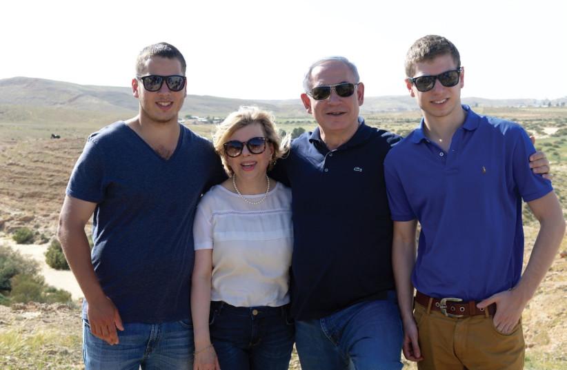 Prime MinisterBenjamin Netanyahu with family, Sara Avner (left) and Yair.   (photo credit: AMOS BEN GERSHOM, GPO)