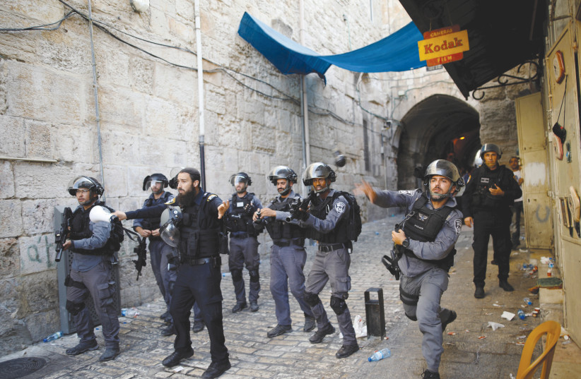 Border police confront protestors in the Old City of Jerusalem. (photo credit: REUTERS)