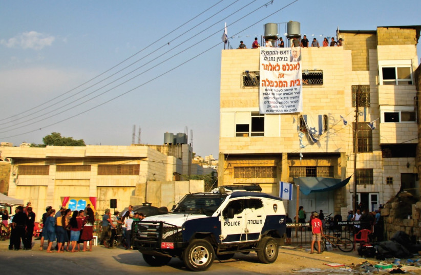 The home in Hebron currently illegally occupied by 15 settler families (photo credit: TOVAH LAZAROFF)