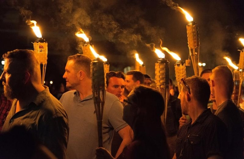 White nationalists carry torches on the grounds of the University of Virginia, on the eve of a planned Unite The Right rally in Charlottesville, Virginia, U.S. August 11, 2017. Picture taken August 11, 2017. (photo credit: ALEJANDRO ALVAREZ/NEWS2SHARE VIA REUTERS)
