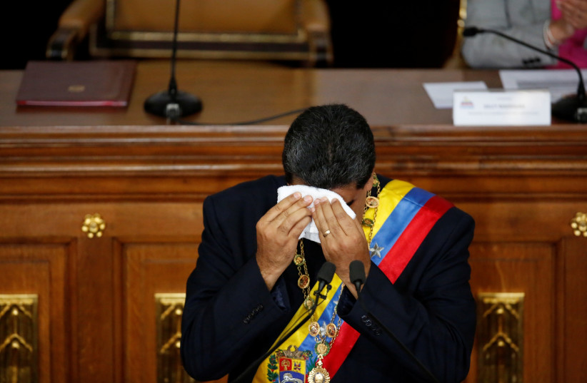 Venezuela's Presidente Nicolas Maduro wipes the sweat from his forehead during a session of the National Constituent Assembly at Palacio Federal Legislativo in Caracas, Venezuela August 10, 2017 (photo credit: CARLOS GARCIA RAWLINS/ REUTERS)