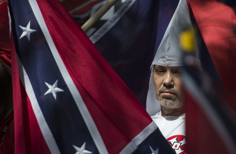 A member of the Ku Klux Klan during a rally in Charlottesville, Virginia, on July 8, 2017.  (photo credit: ANDREW CABALLERO-REYNOLDS / AFP)