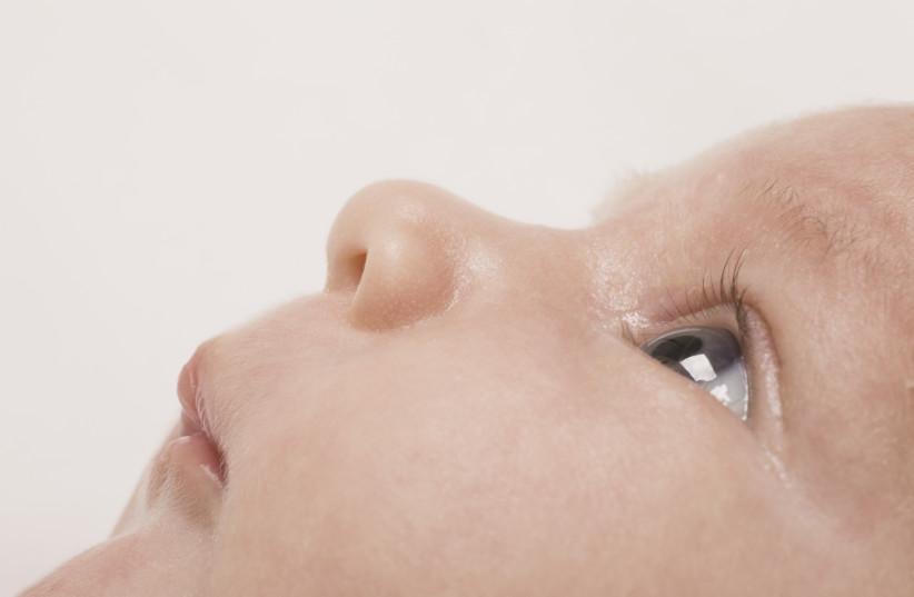 A baby's face. (Illustrative) (photo credit: INGIMAGE)