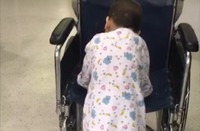Four-year-old Sliman takes first steps after successful surgery (photo credit: HADASSAH MEDICAL ORGANIZASTION)