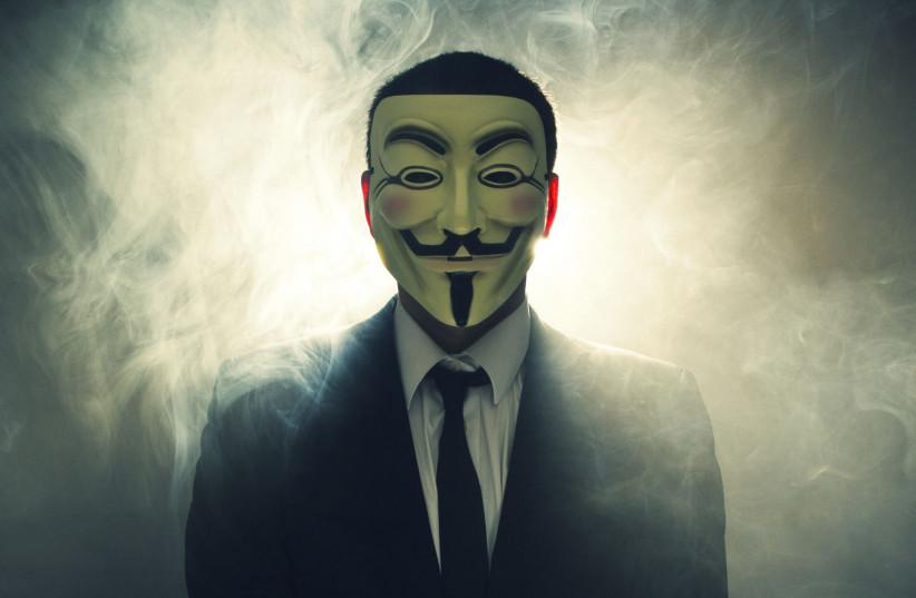 The masked face of international hacker Anonymous (photo credit: WIKIMEDIA)