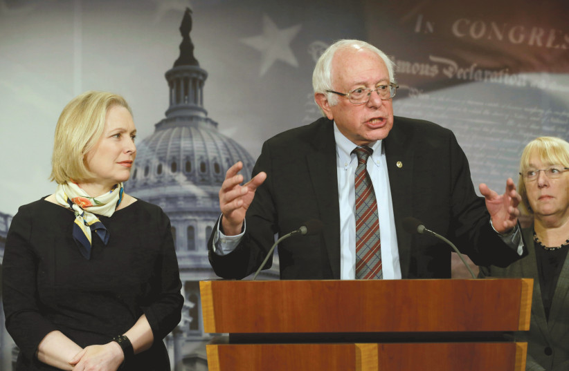 SENATOR BERNIE SANDERS speaks between Sens. Kirsten Gillibrand (left) and Patty Murray during a news conference to unveil the FAMILY Act in Washington in March (photo credit: REUTERS)