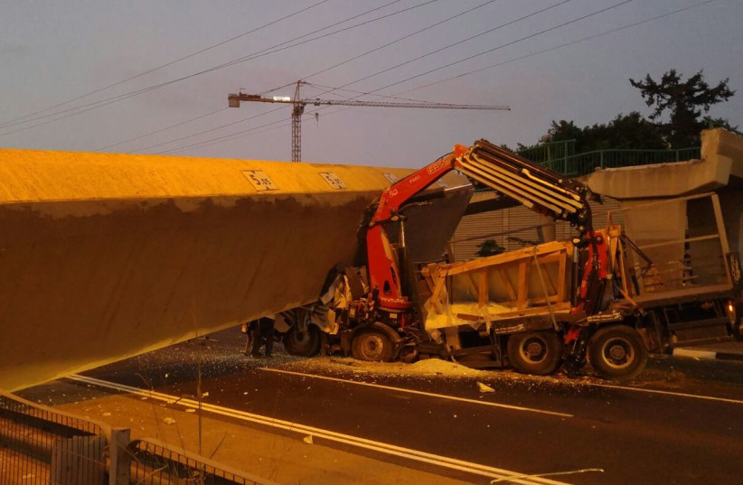 An image from the Monday night pedestrian bridge collapse on Highway 4, between Givat Shmuel and Bnei Brak. (photo credit: COURTESY ISRAEL POLICE)