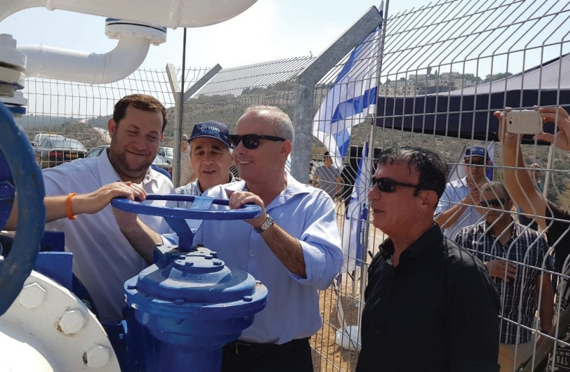 SAMARIA REGIONAL COUNCIL head Yossi Dagan (left), Infrastructure Minister Yuval Steinitz (center) and Civil Administration officer Benny Elbaz inaugurate a 13-km. water pipeline in Samaria on Monday. (photo credit: SAMARIA REGIONAL COUNCIL)