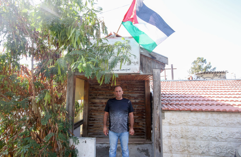 Mohammad Shamasneh in front of his home in home in Sheikh Jarrah, August 15, 2017. (photo credit: MARC ISRAEL SELLEM)