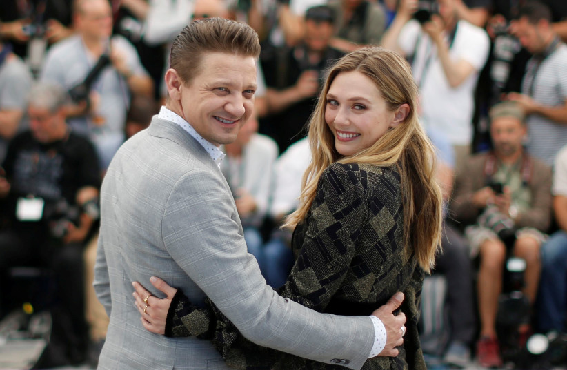 Cast members Jeremy Renner and Elizabeth Olsen pose. (photo credit: REUTERS)