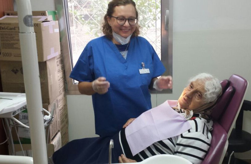 A patient recieves free dentures from Dental Volunteers for Israel (photo credit: Courtesy)