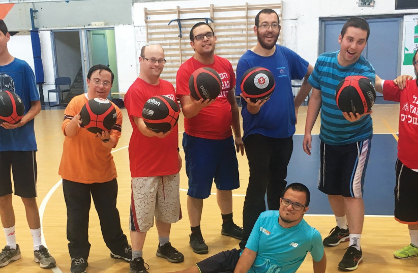 Once a week, Yachad kids participate in English-language basketball training as part of a joint program with Hapoel Jerusalem. (photo credit: OU ISRAEL)