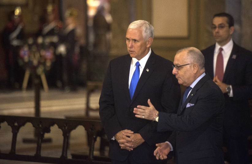 Vice President Mike Pence, left, with Argentine Foreign Minister Jorge Faurie during a wreath-laying ceremony at the Metropolitan cathedral in Buenos Aires. (photo credit: AFP PHOTO)