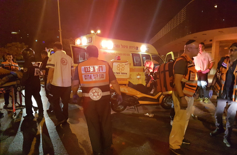 United Hatzalah and Magen David Adom volunteers at the scene of an accident (photo credit: BECKY BROTHMAN)