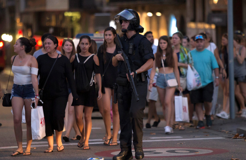 Police evacuate people after a van crashed into pedestrians near the Las Ramblas avenue in central Barcelona, Spain August 17, 2017. (photo credit: REUTERS)