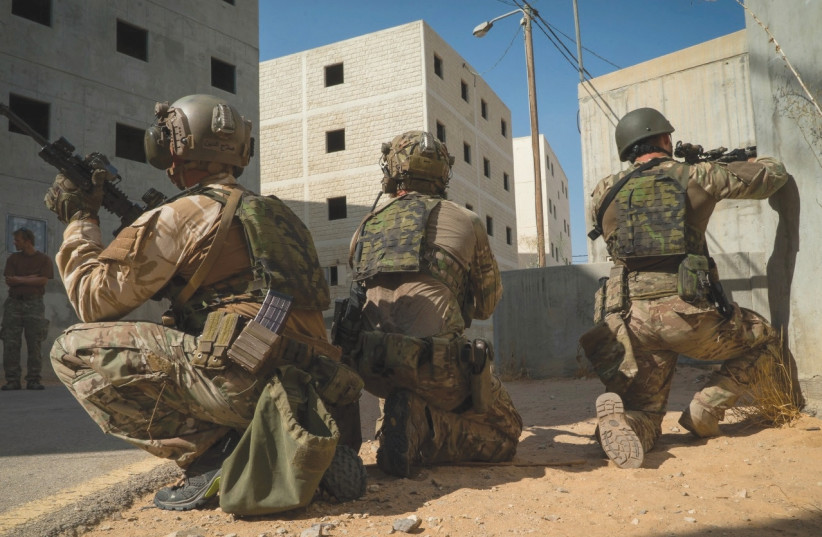 THE IDF'S ELITE Duvdevan unit and the Czech Armed Force's 601st Special Forces Group train together recently in urban-warfare techniques at Tze'elim Army Base in the Negev. (photo credit: IDF)