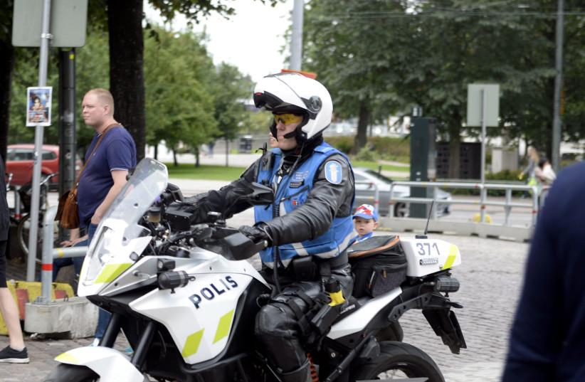 Finnish police patrols on motorbike after stabbings in Turku, in Central Helsinki, Finland August 18, 2017. (photo credit: LEHTIKUVA/LINDA MANNER VIA REUTERS)