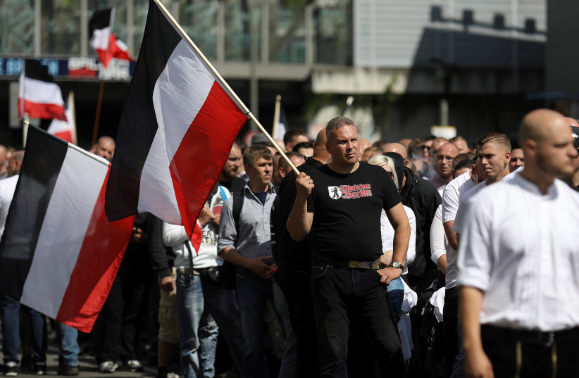 Far-right activists demonstrate to commemorate the suicide of Germany's former Deputy Fuehrer Rudolph Hess 30 years ago, in Berlin, Germany August 19, 2017 (photo credit: REUTERS)