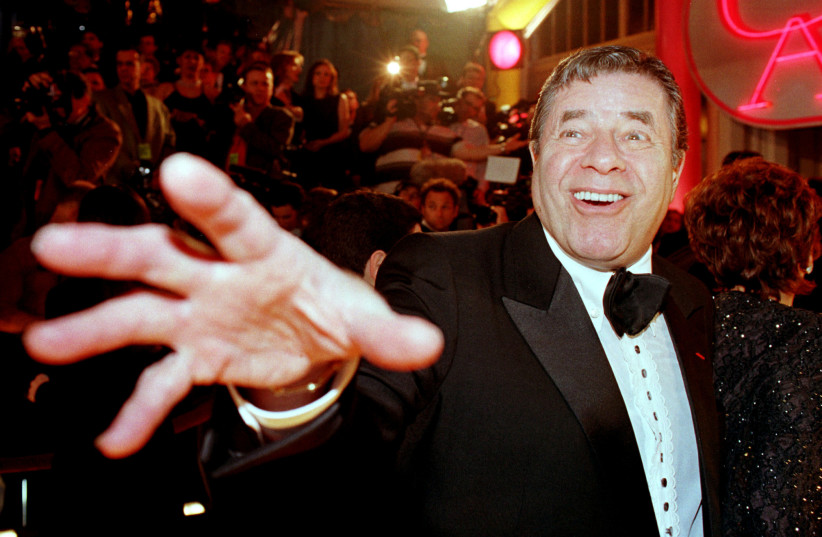 Comedian Jerry Lewis reaches out to cover the camera lens as he arrives at the 12th annual American Comedy Awards. (photo credit: REUTERS)