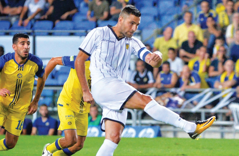 Beitar Jerusalem striker Itay Shechter scored two goals in last night's 3-0 win at Maccabi Tel Aviv in Premier League action in Netanya. (photo credit: ARIEL SHALOM)