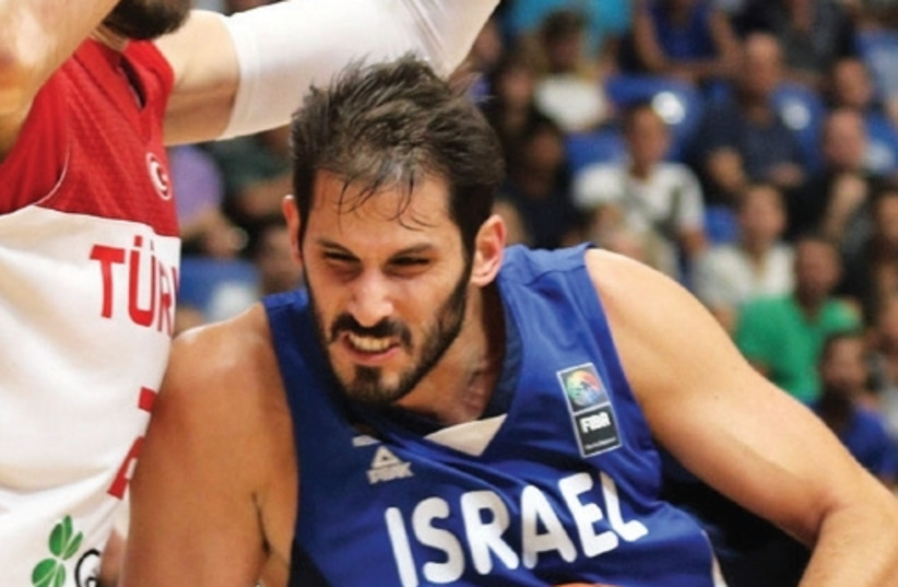 Israel forward Omri Casspi led the national team with 18 points and 10 rebounds at Yad Eliyahu Arena last night, but it wasn't enough for the blue-andwhite, which suffered an 84-83 defeat to Turkey. (photo credit: ADI AVISHAI)
