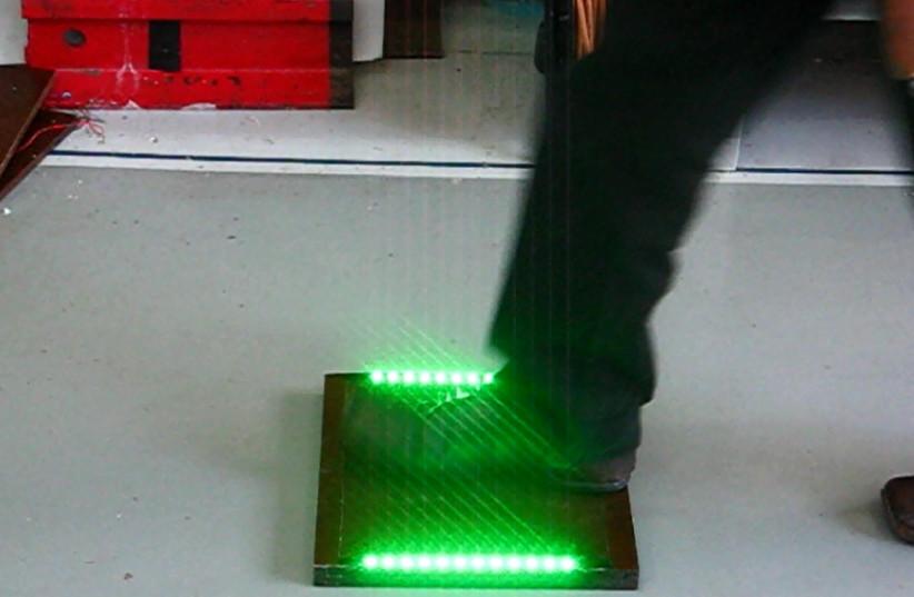 An Innowattech piezoelectric plate lights up (photo credit: INNOWATTECH)