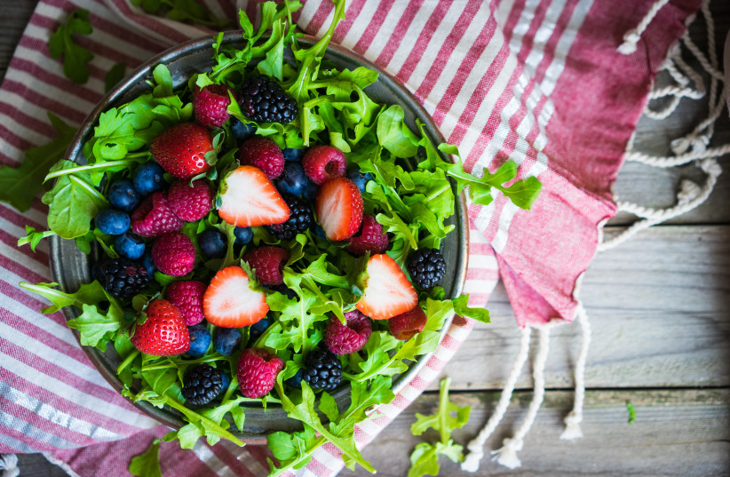 Green salad with arugula and berries (photo credit: INGIMAGE)