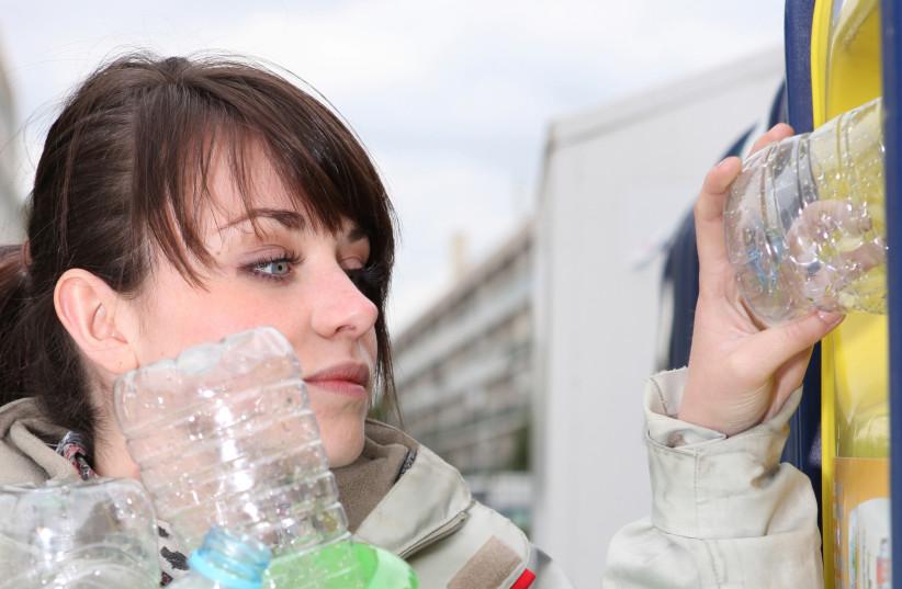 Woman recycling (Illustrative) (photo credit: INGIMAGE)