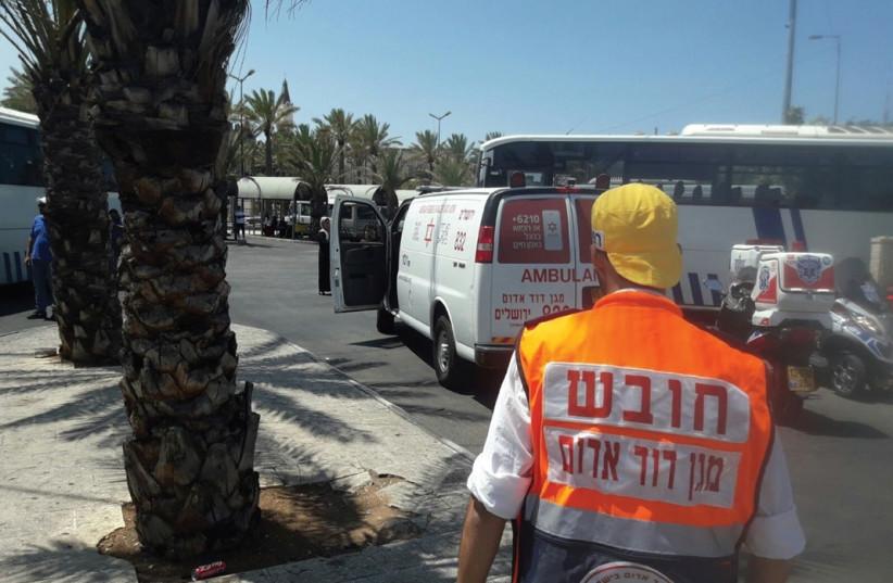 MAGEN DAVID ADOM medics work at the scene of the August 12 stabbing attack near Damascus Gate in Jerusalem. (photo credit: MDA)