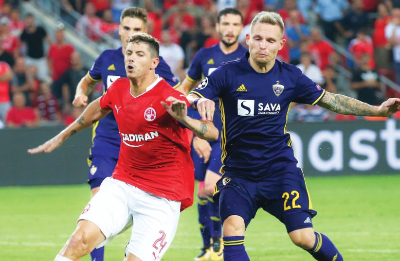Hapoel Beersheba midfielder Maor Melikson (left) is set to be handled roughly by Maribor players, including Martin Milec, once more tonight when the teams clash in the second leg of the Champions League playoffs in Slovenia. (photo credit: DANNY MARON)
