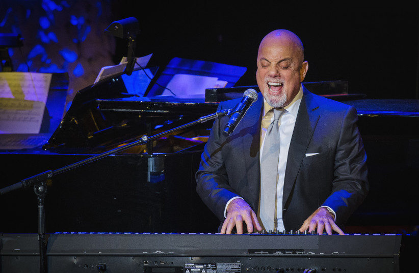 Billy Joel performs after accepting an award at the American Society of Composers, Authors and Publishers Centennial Awards in New York, November 17, 2014 (photo credit: REUTERS/LUCAS JACKSON)