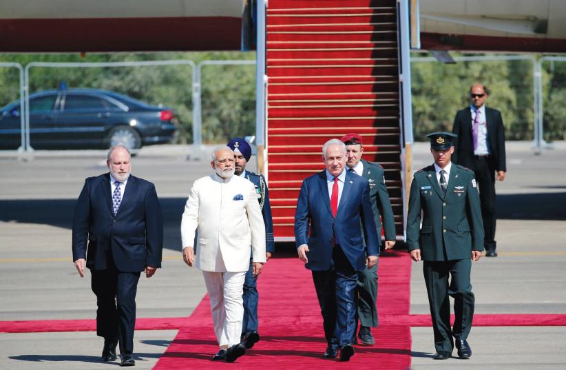 Meron Reuben joins Prime Minister Benjamin Netanyahu in welcoming Indian Prime Minister Narendra Modi to Israel on July 4. (photo credit: REUTERS)