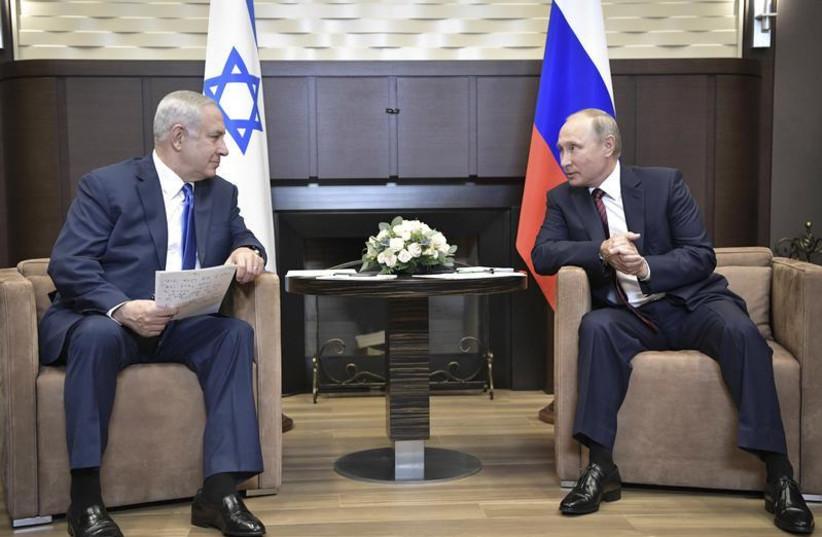 Russian President Vladimir Putin (R) meets with Israeli Prime Minister Benjamin Netanyahu in Sochi, Russia August 23, 2017. (photo credit: SPUTNIK/ALEXEI NIKOLSKY/KREMLIN VIA REUTERS)