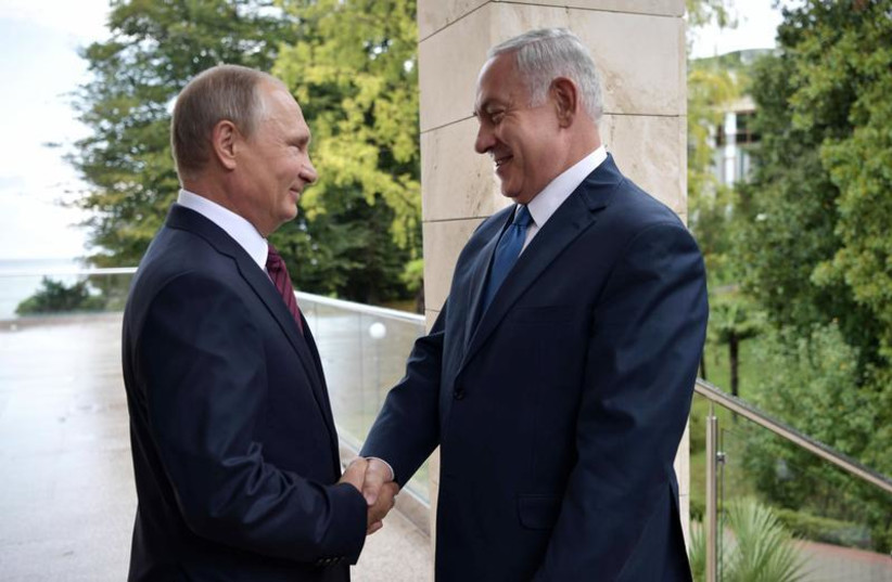 Russian President Vladimir Putin (L) welcomes Israeli Prime Minister Benjamin Netanyahu in Sochi, Russia August 23, 2017. (photo credit: SPUTNIK/ALEXEI NIKOLSKY/KREMLIN VIA REUTERS)