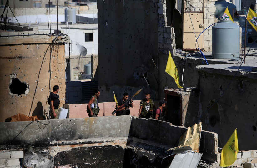 A Palestinian Fatah fighter holds a weapon inside the Ain el-Hilweh refugee camp near Sidon, southern Lebanon. (photo credit: REUTERS)