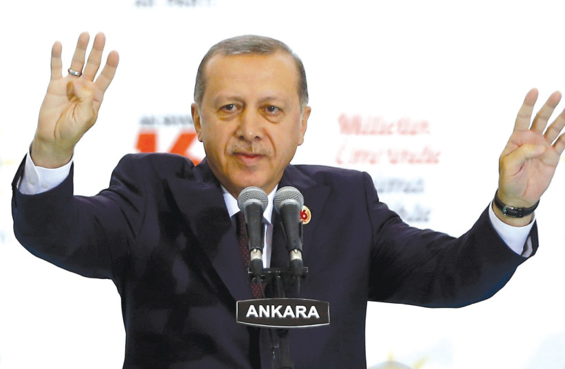 TURKISH PRESIDENT Recep Tayyip Erdogan greets the audience during a ceremony to mark the 16th anniversary of his ruling AK Party's foundation in Ankara, August 14. (photo credit: UMIT BEKTAS / REUTERS)