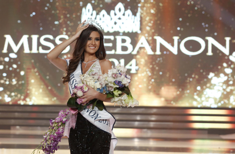 Sally Greige holds her tiara after being crowned Miss Lebanon. (photo credit: REUTERS)