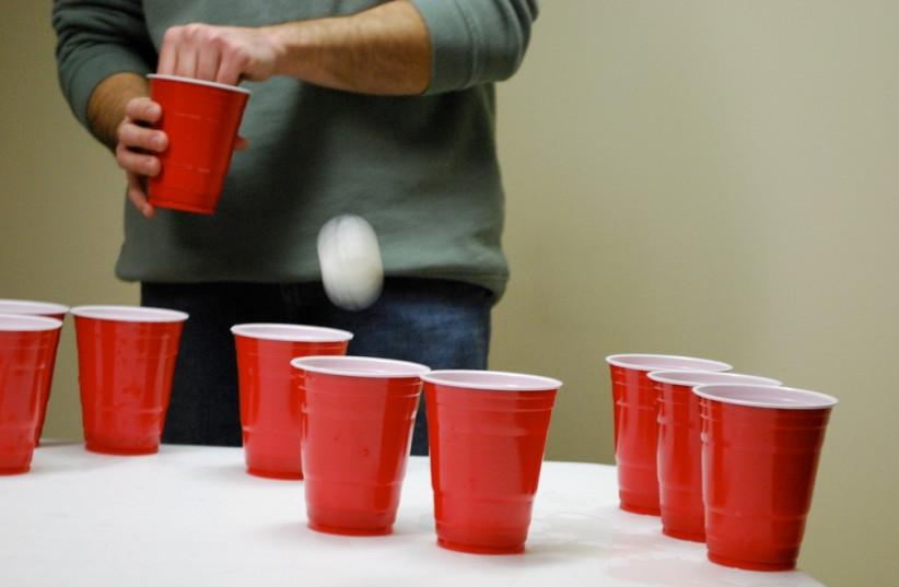 Beer pong (photo credit: LAURA LAROSE/ FLICKR)