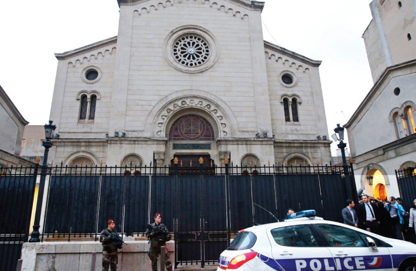 SOLDIERS AND a police car stand in front of a synagogue in Marseille, France. (photo credit: REUTERS)
