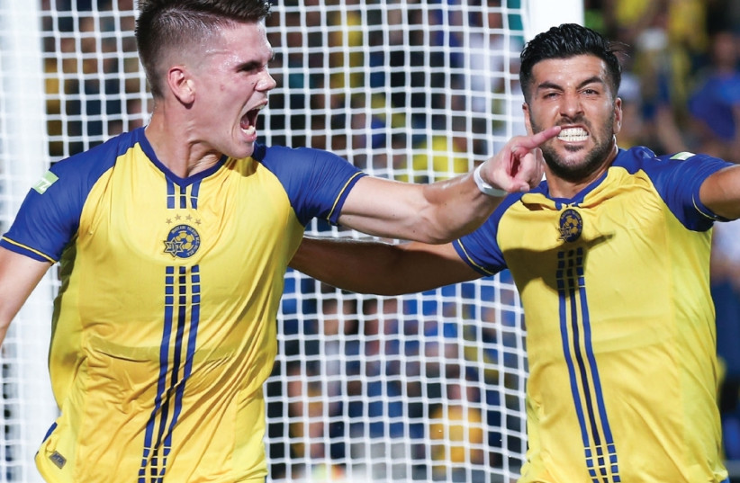 Maccabi Tel Aviv striker Vidar Orn Kjartansson (left) celebrates with teammate Avi Rikan after scoring in last night's 2-2 draw against Altach in Netanya which sent the yellow-and-blue through to the Europa League group stage. (photo credit: DANNY MAROM)