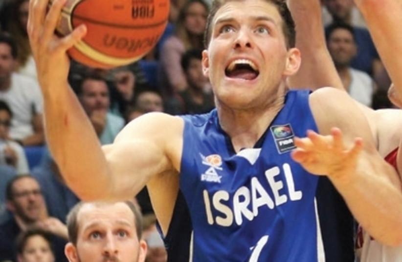 Israel guard Gal Mekel scored 12 points in last night's 77-74 win over Poland in EuroBasket tuneup action in Warsaw. (photo credit: ADI AVISHAI)