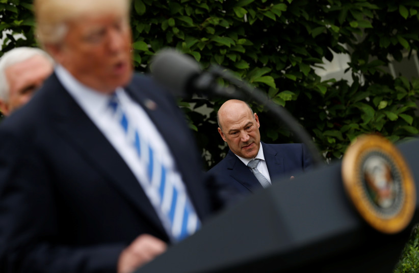 White House National Economic Council Director Gary Cohn listens as US President Donald Trump delivers remarks in the Kennedy Garden at the White House in Washington, US, May 1, 2017 (photo credit: REUTERS)