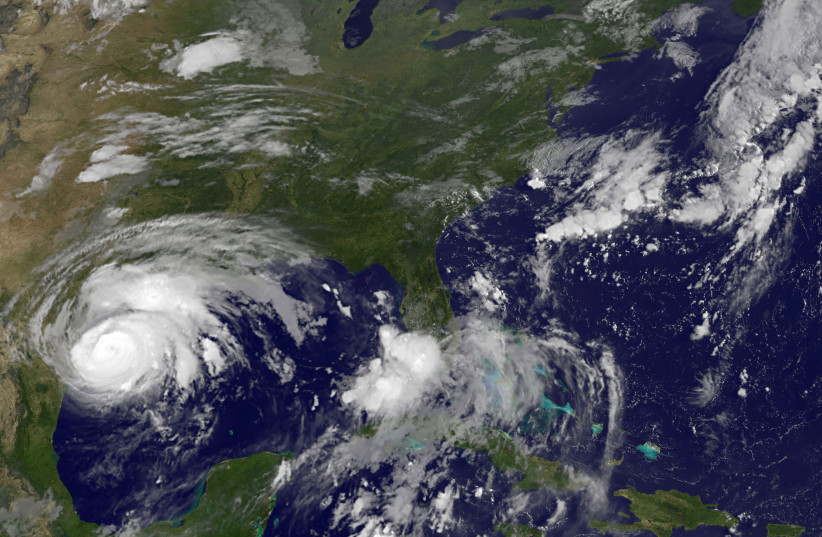 Hurricane Harvey is seen approaching the Texas Gulf Coast, U.S.,in this NOAA GOES East satellite image taken at 7:07 ET (11:37 GMT) August 25, 2017 (photo credit: NOAA/HANDOUT VIA REUTERS)